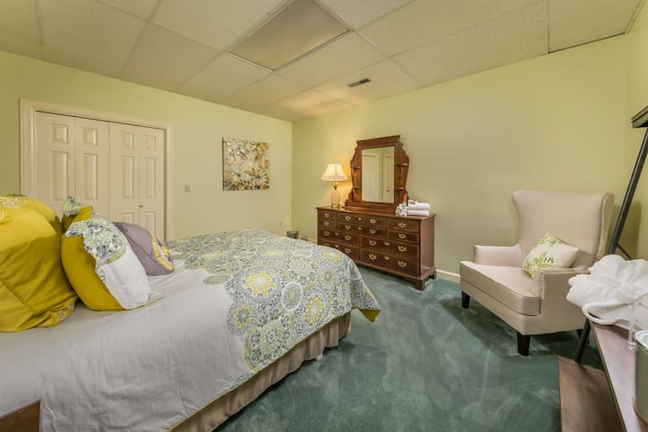 Collard Green Suite Downstairs with king size bed and attached shared bath