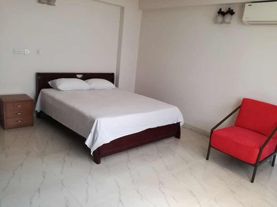 This the second room of our apartment. There is also one attached bathroom, one king size bed with one side drawer, one single sofa chair. Air Condition is also available.