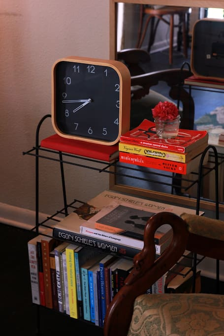 Books, books, and more books. Don't ask the time. That clock is decorative.