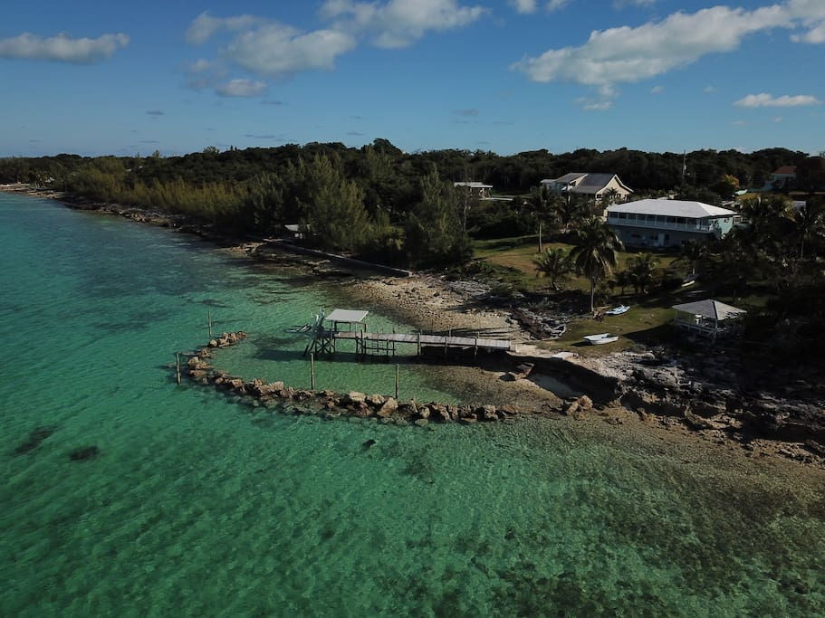 Seagrape by the Sea aerial view of apartment, private dock, beach area and cabana from the Sea of Abaco.