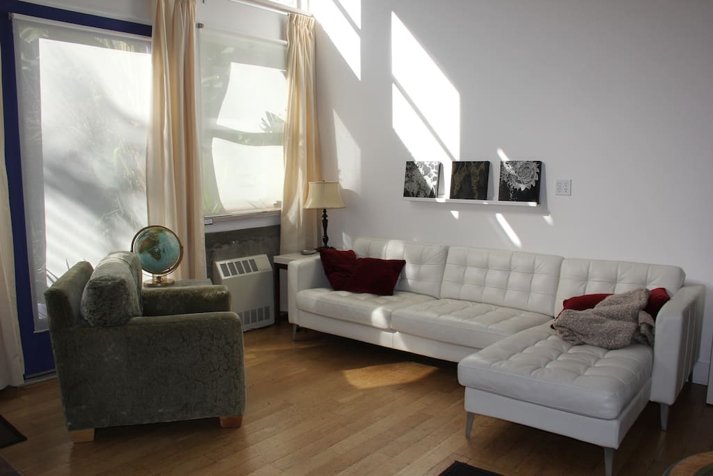 Sunny room has big couch