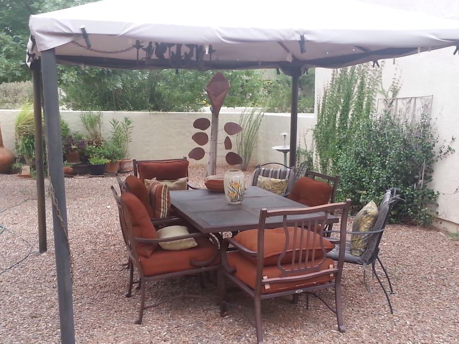 Outdoor dining under the gazebo