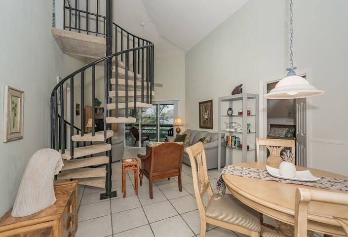 Spiral stairs take you to the loft.