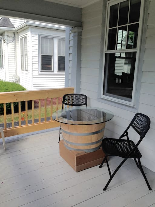 The front porch is also set up with a table and chairs- a perfect place to enjoy a meal.