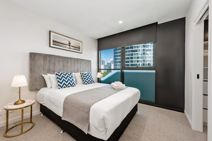 Master bedroom with ultra-comfortable bed and deluxe ensuite