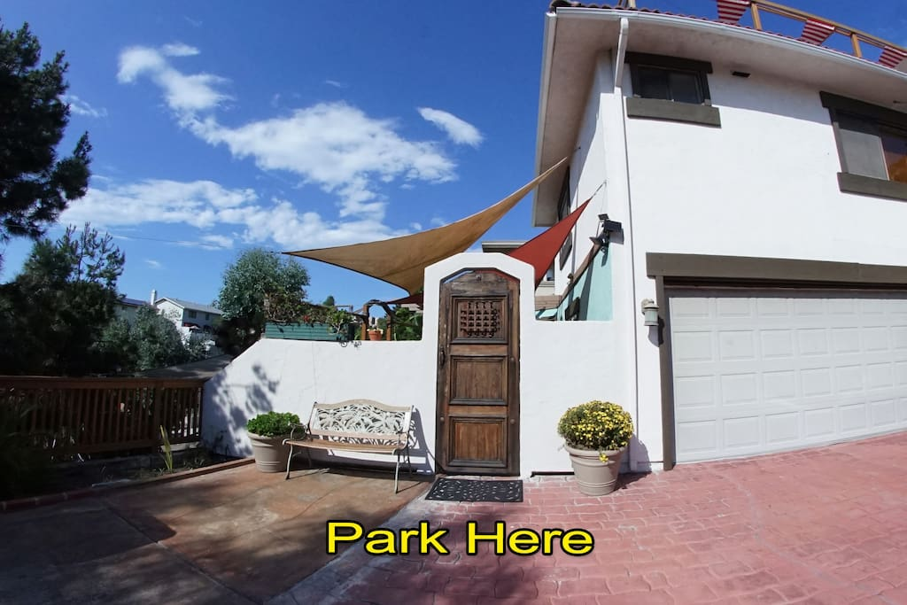 Your private parking space for 2 with entrance through tall wooden door.