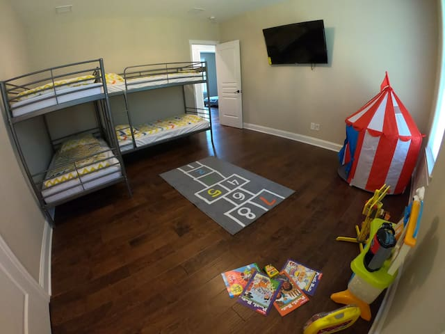 Bedroom 1/Kids bedroom. Two twin bunk beds. Sleeps 4. Space for your own crib/pack and play.