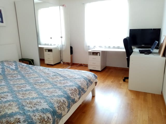 bedroom with double bed and office desk