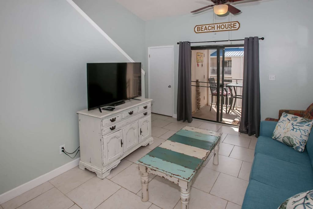Living room with flat screen TV and balcony