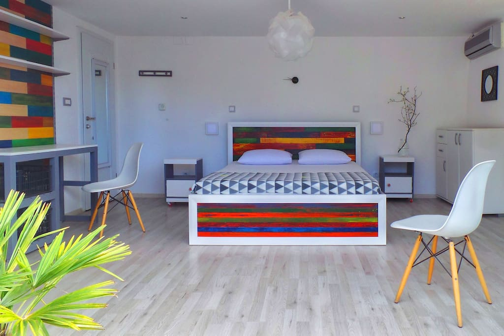 Private room (Room A: ~20m2) with balcony. 2-person (queen size) bed (~1.5x2m).