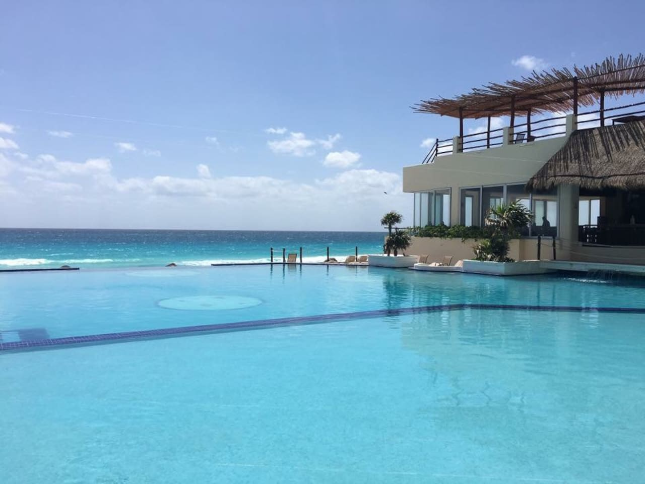 Infinity pool, private beach, restaurant and pool bar with amazing views.