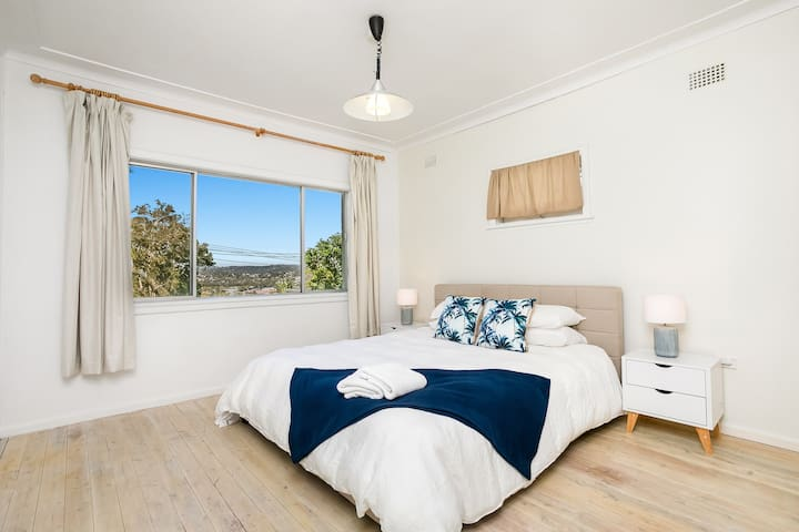 Spacious master bedroom with king bed. Wake up to the beautiful landscape.