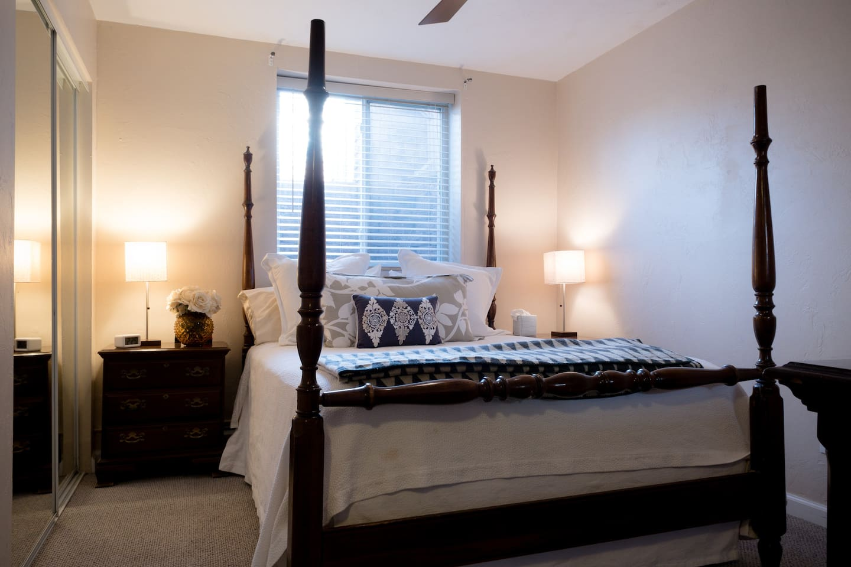 Bedroom 1, queen bed, ceiling fan, huge closets, large dresser and mirror