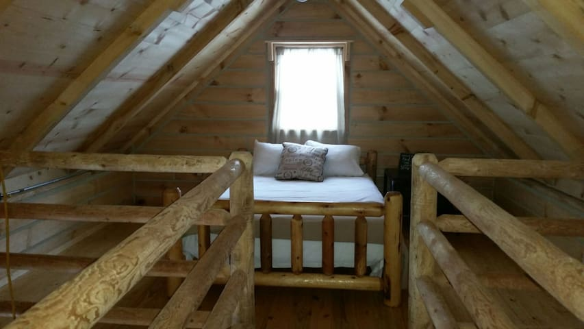 Open Loft located upstairs for guest sleeping.