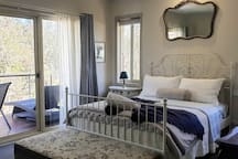 The Queen bed in the Beautiful West Wing adjoining the sundrenched  Private Balcony