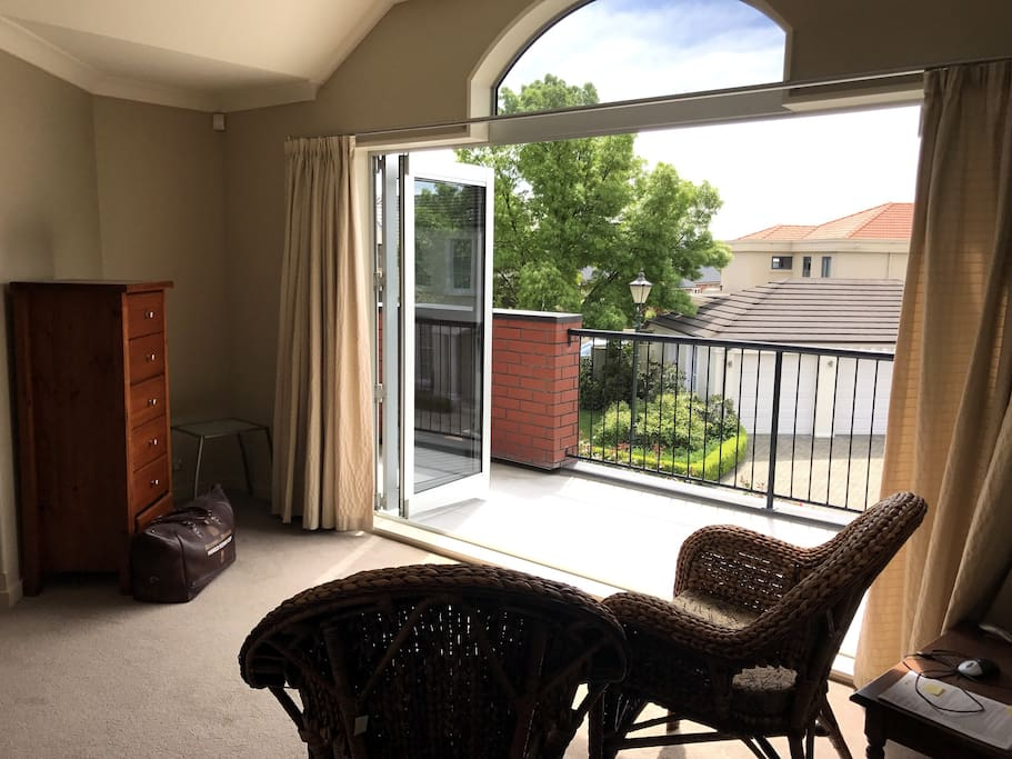 Upstairs lounge with french doors opening  onto Balcony