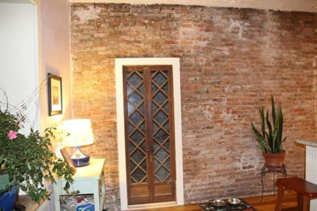 Kitchen leading into original Kitchen/Brick Oven Room