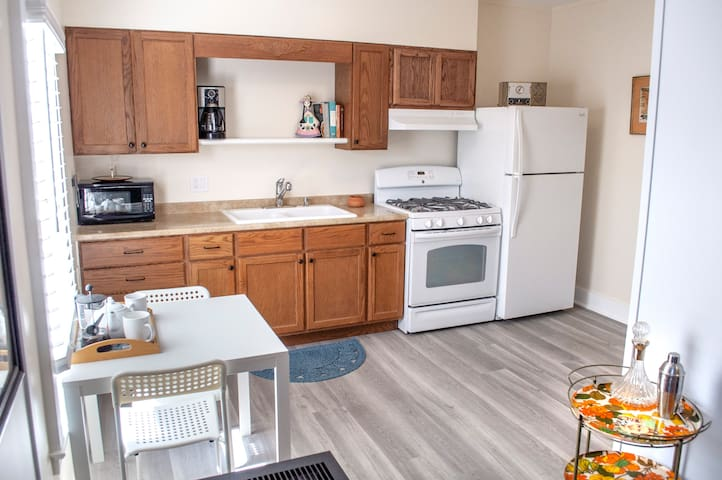 Cook like at home in your full kitchen. Full sized refrigerator. Stove, coffee maker, French press, toaster, etc.