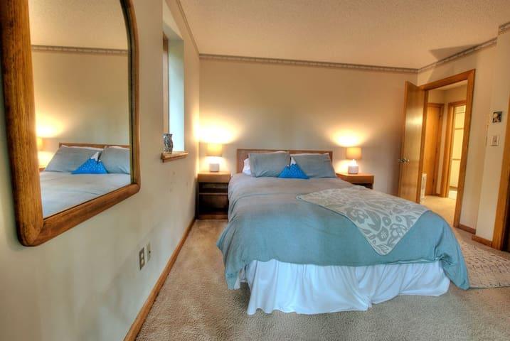 Downstairs bedroom queen - walk out to deck (4 of 5 bedrooms)