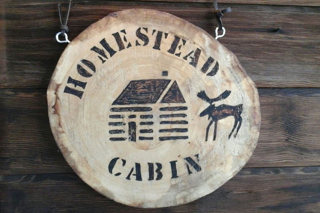 Cabin sign to the right of the cabin door entrance.