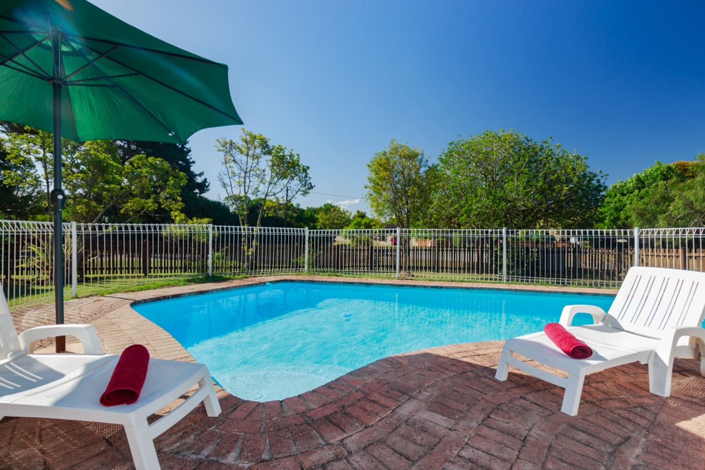Sparkling fenced swimming pool