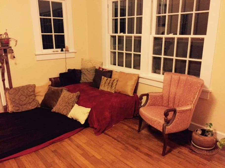 Futons in living room that can be used as beds if needed