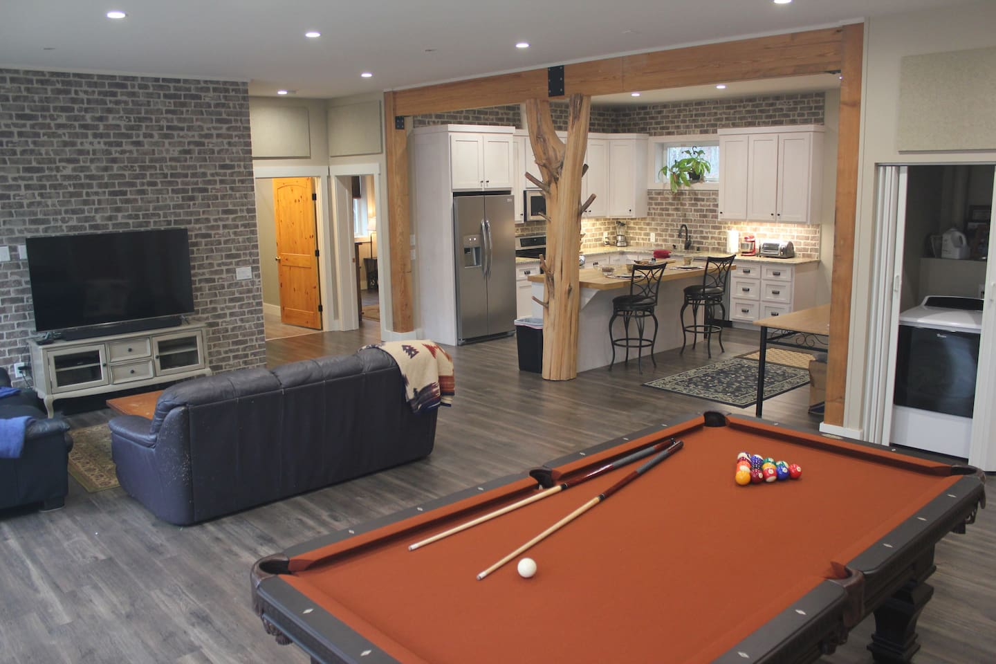 The Terrace Level Escape, full sized pool table, kitchen and living area with 10' ceilings