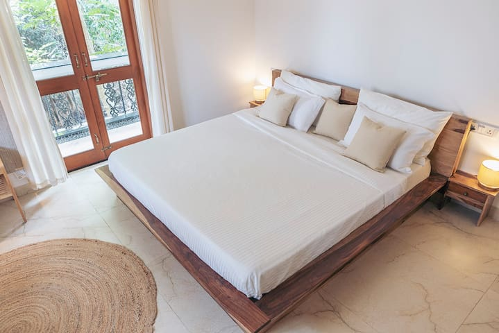 King size bed in the first floor bedroom