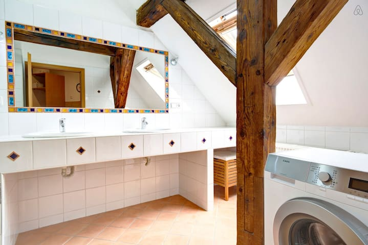 Italian style bathroom with washing machine (available for guests)