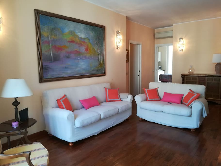 The bright livingroom features two sofa and wide screen TV