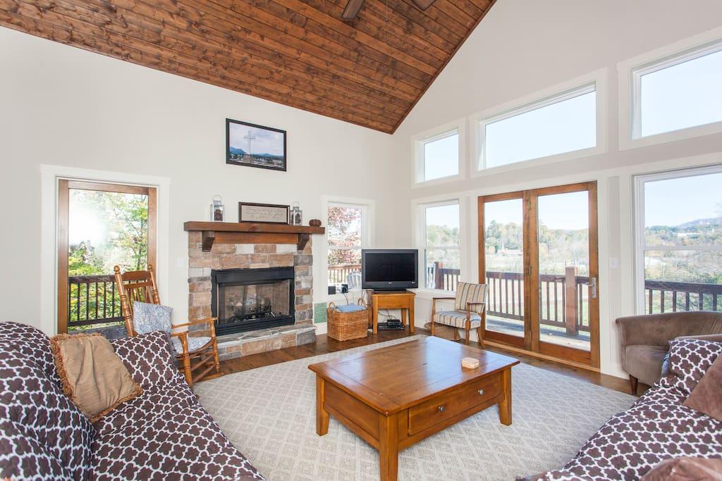 Warm up in front of the gas fireplace in the living room, which also has vaulted ceilings and comfortable seating for 8.