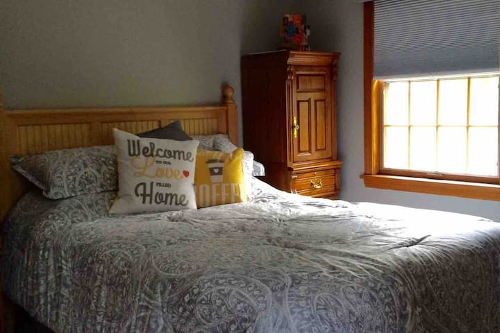 Comfy queen bed with a selection of bed pillows.