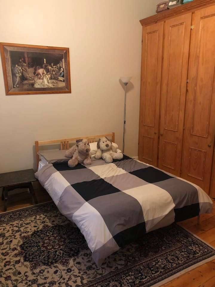 Double bed with cupboard space
