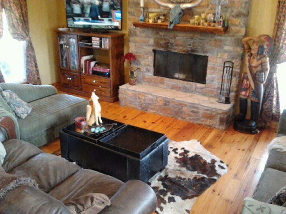 "Spacious great room with 50"" TV, DVD player, fireplace, 3 sofas, working fireplace"