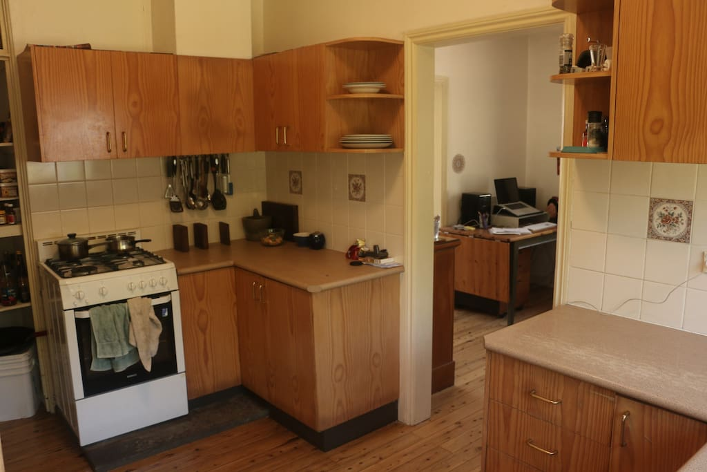 Well equipped kitchen leading to dining room.