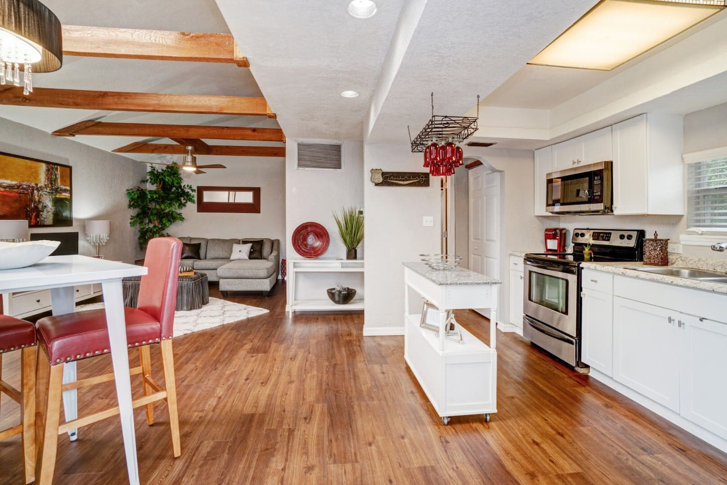Contemporary decorated open loft with stainless steel appliances, Shaker cabinets, and full kitchen.