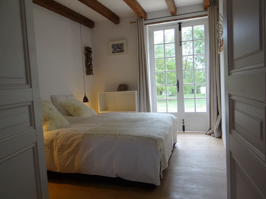 the bedroom overlooking the park-like garden, 2 single beds