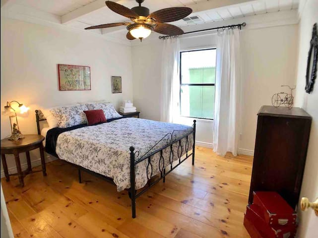 This is the largest bedroom and located in the center of the three.