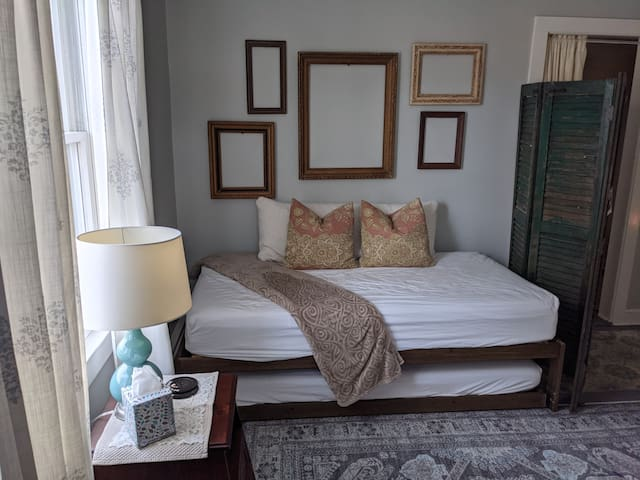 Trundle bed with (2) twin mattresses. Down alternative comforters and fresh lines laundered with dye free detergent. This room has a room screen and a curtain in the doorway for privacy.  Great natural light if desired.