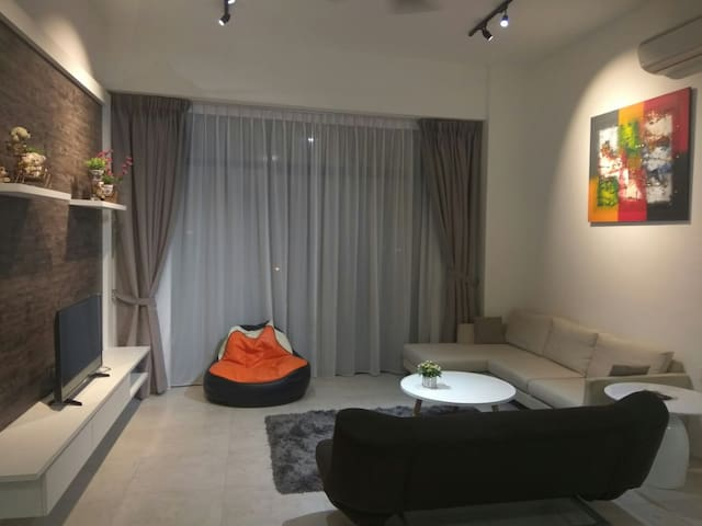 """Living hall c/w 43"""" smart LED TV, free WiFi, air conditioning, sofa bed, L shape sofa, day and night curtain, etc"""