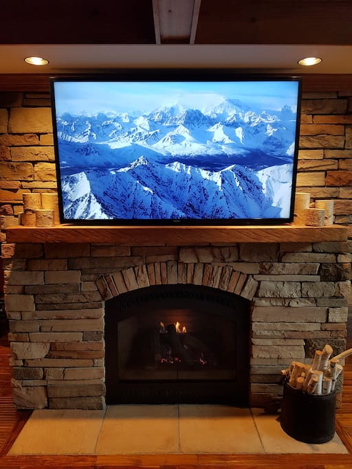 "Main living room with gas fireplace and 55"" Smart TV"
