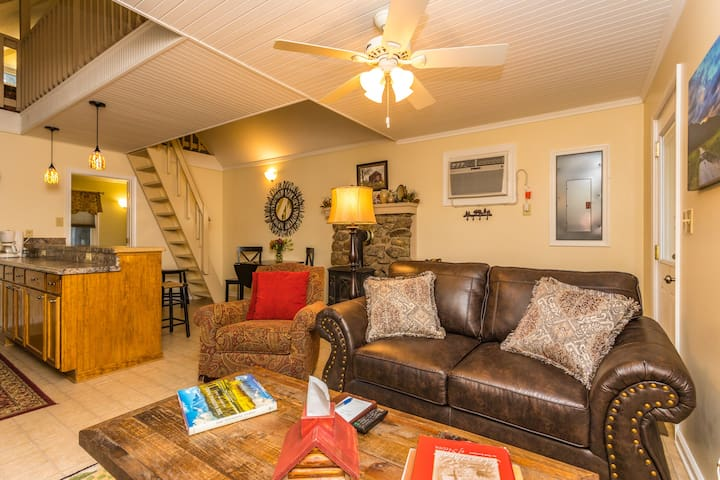 Jack's Place has a comfortable living space with a sofa chair and leather love seat for relaxing and watching movies in the evenings!