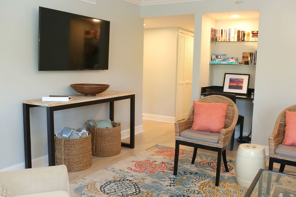 New smart TV and plenty of seating in bright and cheery living area