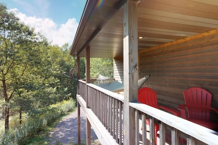 Cozy cabin-style home w/ private hot tub and entertainment - dogs welcome!