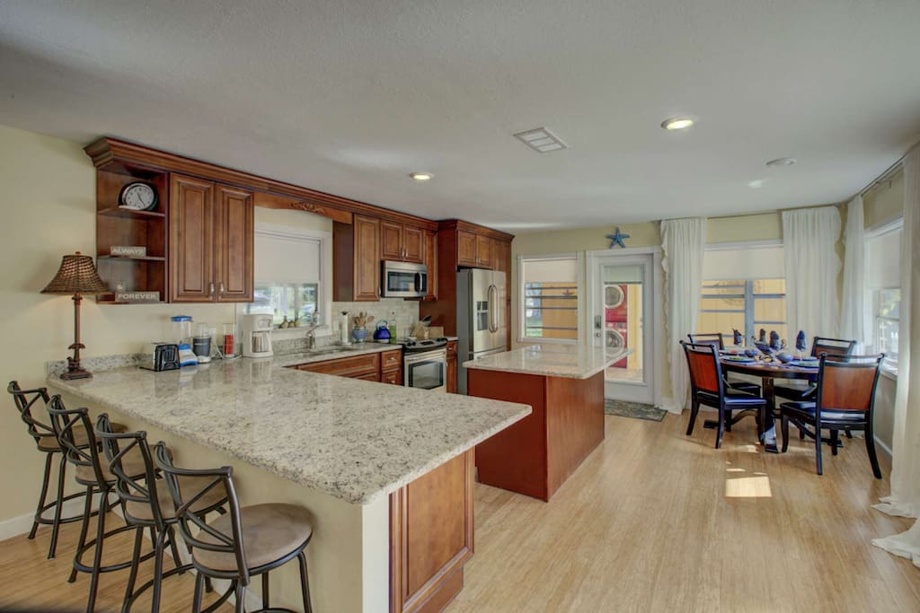 There is a large, beautifully update kitchen with breakfast nook for 4 as well as dining space for 4 people.