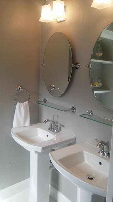 Double pedestal sinks and mirrors in master bath