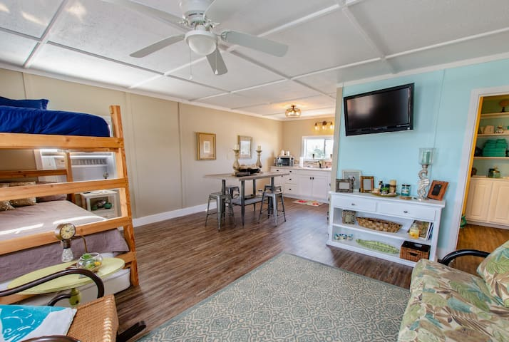 Upstairs kitchenette Living room and set of full bunk beds with futon