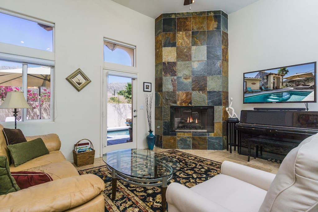 """Seating faces the 55"""" flat screen TV and fireplace in the living room"""