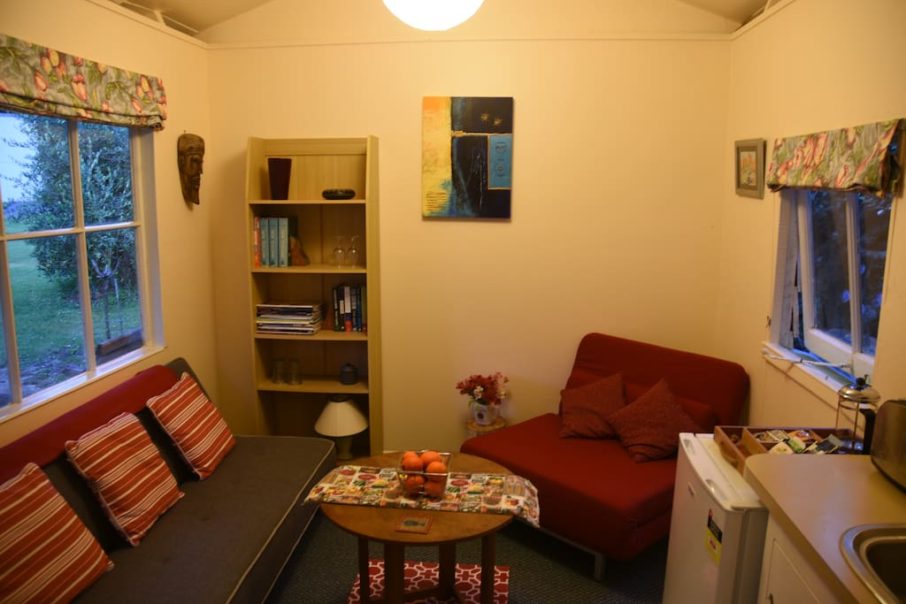 Living area with a range of books and magazines for guest use.