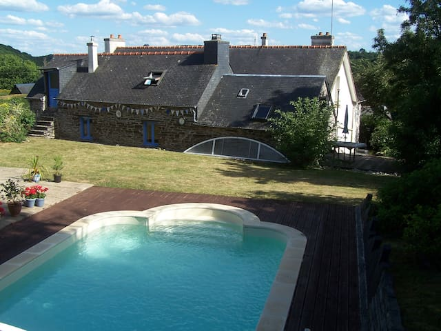 view of gite and lawn from pool area